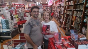 Mark Norris gets his niece's book signed by Cheryse Durrant at Dymocks Carindale
